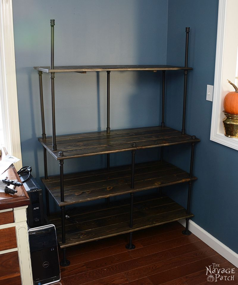Of Pipe and Pine | DIY Industrial bookcase | DIY industrial shelves | DIY bookcase made with pipe and pine boards | Rustic wood shelves | Rustic bookcase | How to make a bookcase | Office storage solution | Simple organization and storage | DIY Industrial furniture | TheNavagePatch.com