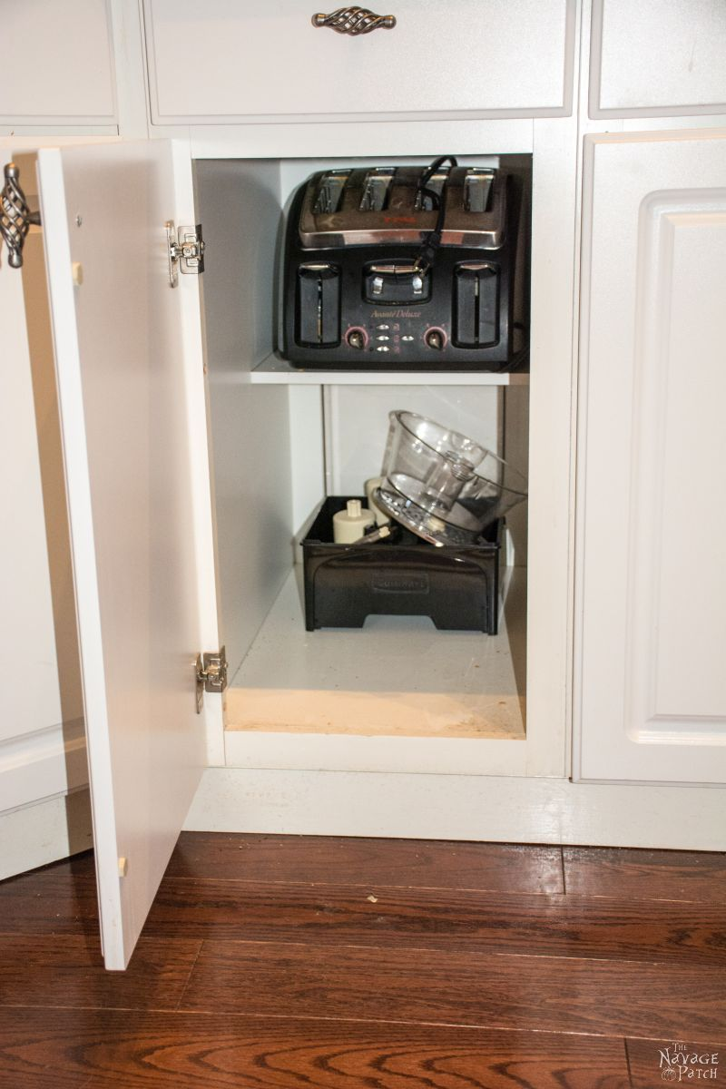 cabinet with toaster and food processor