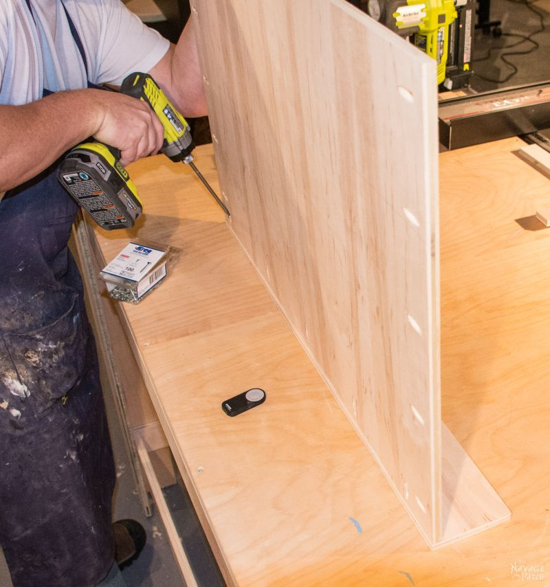 man building slide out shelves with pocket screws