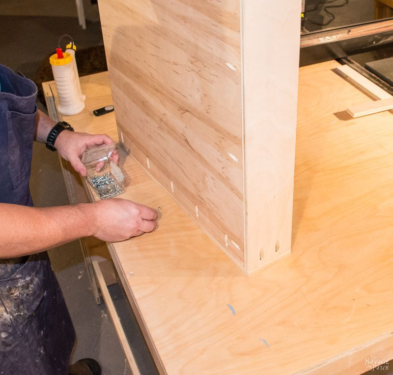 man building a sliding shelf