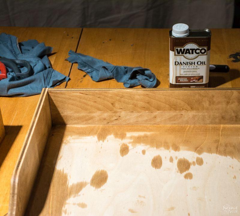 danish oil on table behind diy slide out shelf