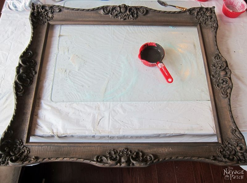 Ornate Frame to Wall Clock   Upcycled picture frame   How to make a wall clock from picture frame   DIY painted and stenciled wall clock   Homemade chalk paint recipe   DIY farmhouse style home decor   How to use white wax   Ornate picture frame makeover   How to build a stylish clock   How to stencil   TheNavagePatch.com