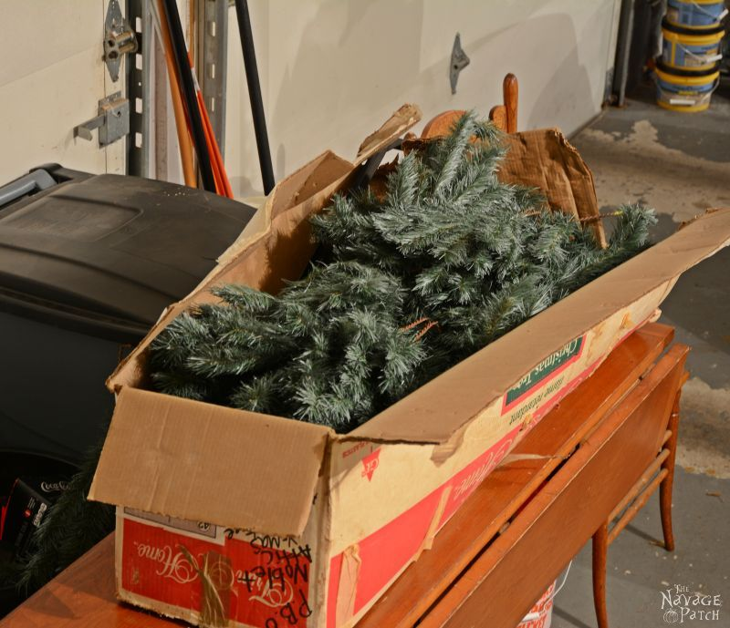 faux christmas tree branches in a box