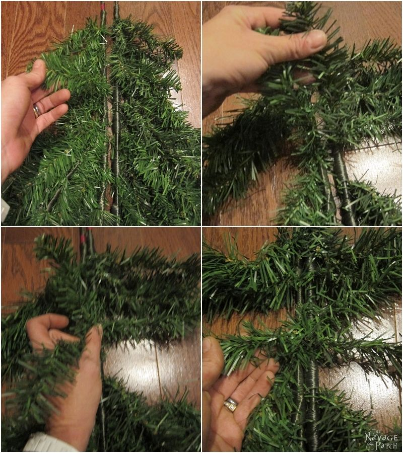 woman tying two faux christmas tree branches together