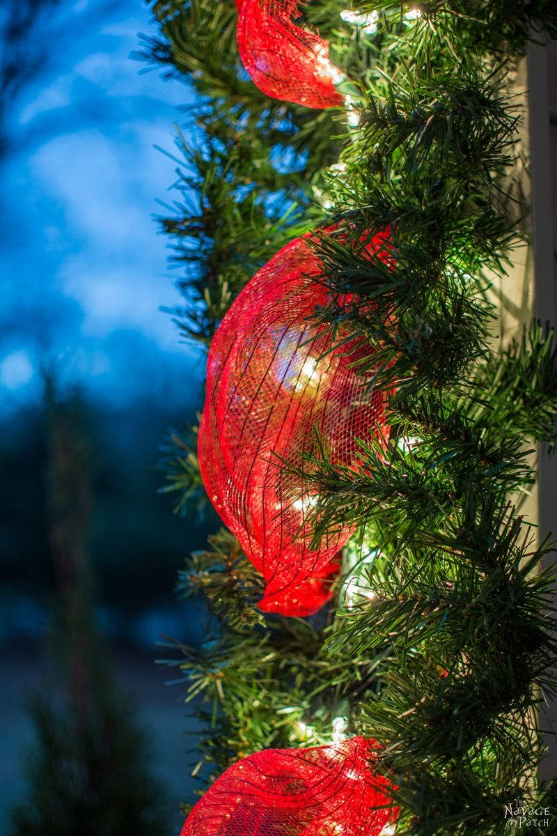 Faux Christmas Tree Repurposed into a DIY outdoor Christmas garland