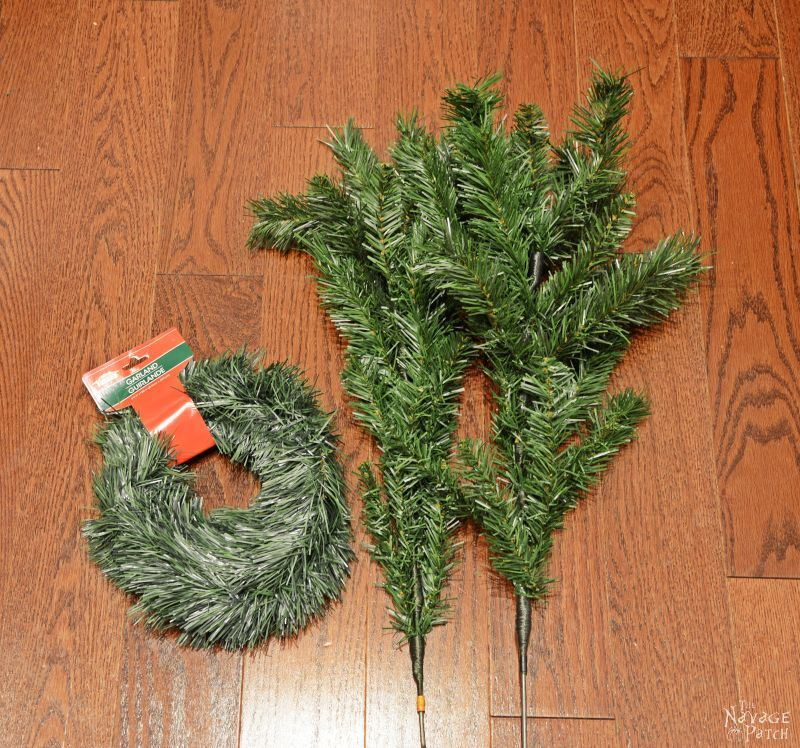 fake christmas tree branches on a floor