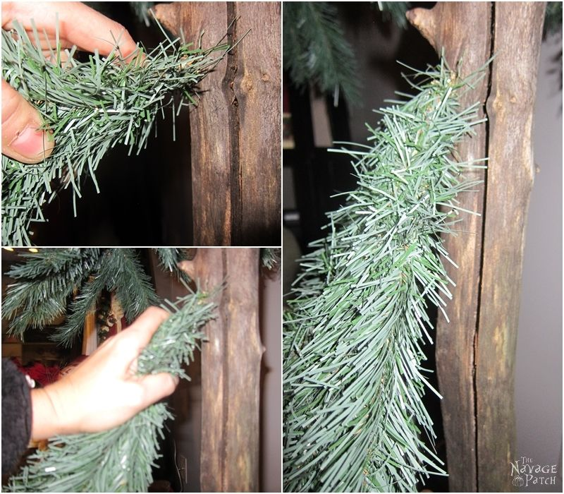 woman inserting faux chritsmas tree branches into a real tree branch