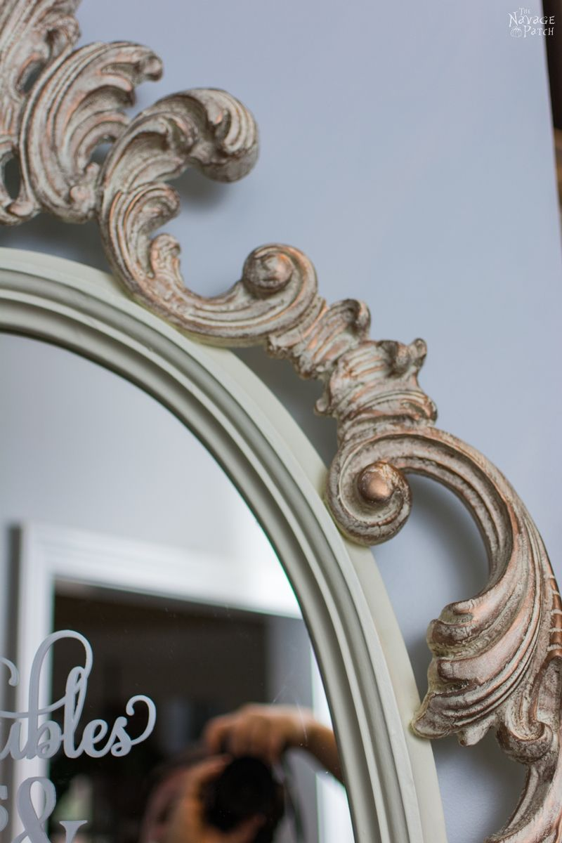 Ornate Mirror Makeover | Updating an ornate mirror with frosted glass spray and homemade chalk paint | How to use metallic wax | DIY chalk paint recipe | Free stencil printable | Free Irish Blessing Printable | DIY furniture makeover | French country decorating | Annie Sloan Old White color | How to use homemade chalk paint with paint sprayer | Wagner paint sprayer | Before & After | TheNavagePatch.com