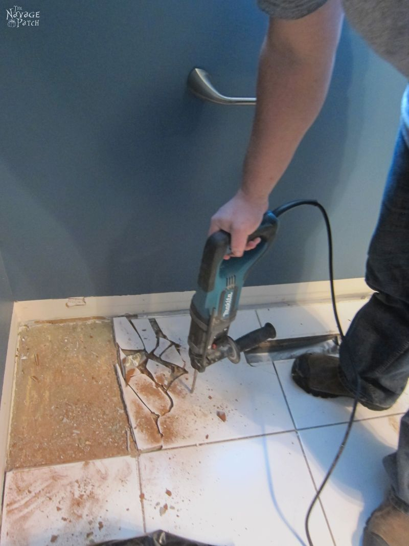 Guest Bathroom Renovation | How to remove a baseboard |How to remove floor tiles |The easy way of removing tile flooring | How to remove flooring the easy way | How to remove a toilet | DIY guest bathroom makeover | DIY Powder room makeover | DIY bathroom renovation | Before & After | TheNavagePatch.com