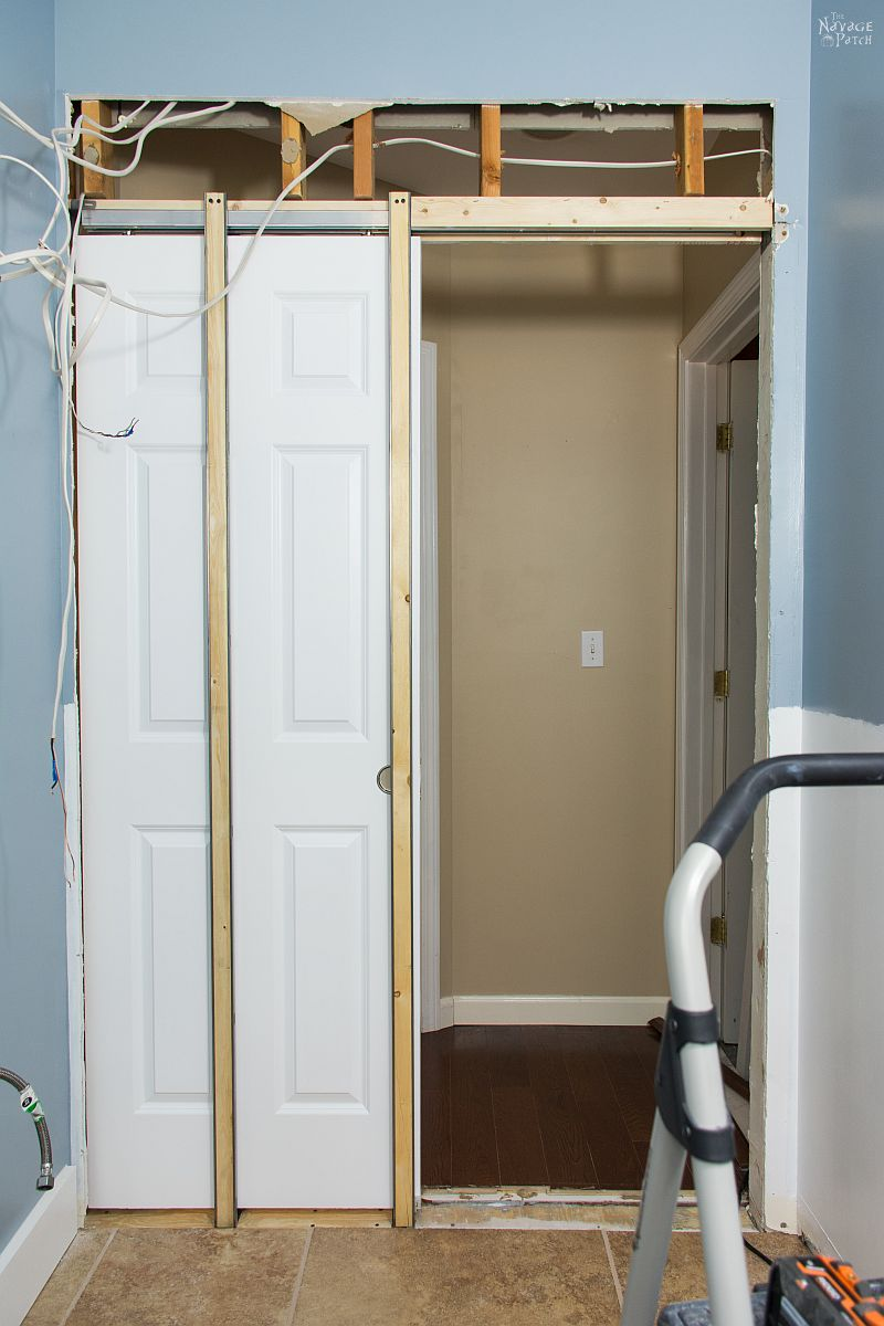 Guest Bathroom Renovation | DIY pocket door installation | How to install a pocket door | How to cut a door opening in a wall | How to make a door opening |How to paint a door | Before and After | TheNavagePatch.com