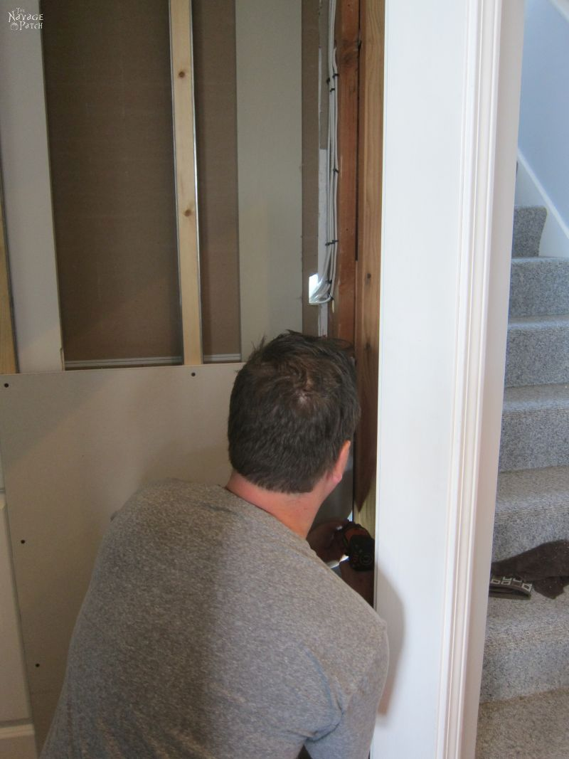 Guest Bathroom Renovation | DIY pocket door installation | How to install a pocket door | How to install drywall | How to install a door jamb | DIY board and batten wainscoting | Before and After | TheNavagePatch.com