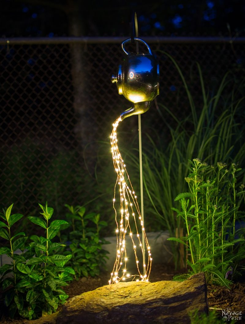 DIY Spilling Solar string Lights (Teapot Lights) in a garden at night