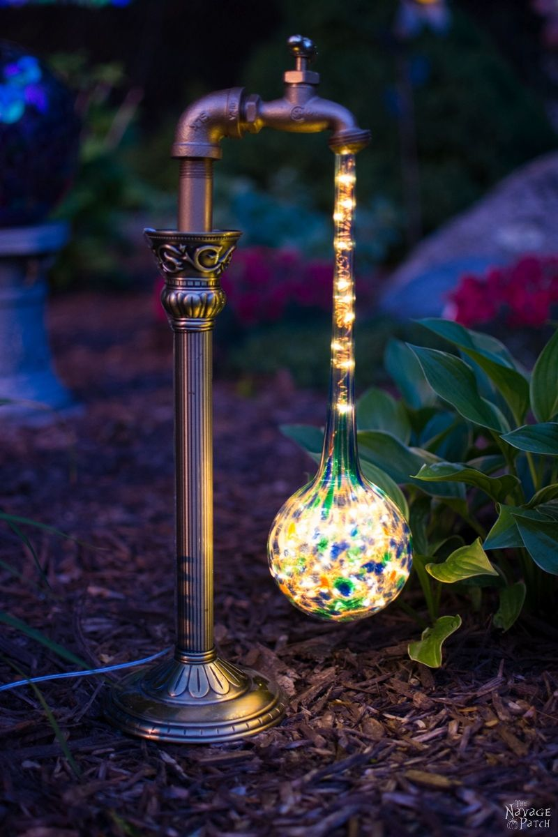 DIY Waterdrop Solar Lights | Step-by-step tutorial for DIY waterdrop solar lights | Upcycled candle sticks | Upcycled plant watering globes | DIY whimsical garden lights | #TheNavagePatch #DIY #Upcycled #Recycled #SolarLights | Easy, budget friendly DIY backyard ornaments and landscape lights | DIY garden lights | TheNavagePatch.com