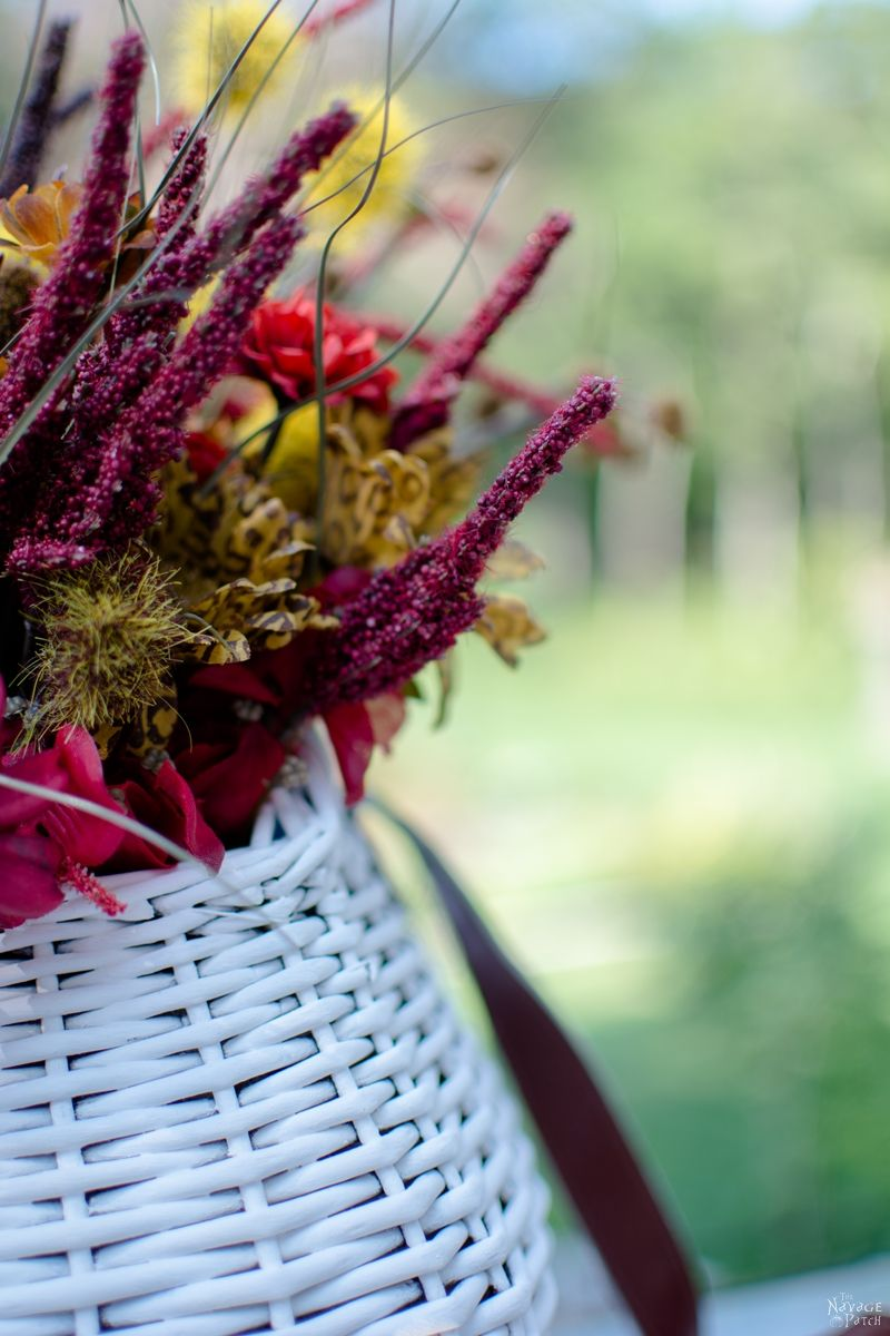 DIY Fall Flower Topiary and Hanging Flower Basket   DIY Basket Makeover   How to make a flower topiary   Upcycled and repurposed old fashioned fishing creel   How to paint a wicker basket   Dollar store crafts   Easy and budget friendly home decor   Before & After   TheNavagePatch.com