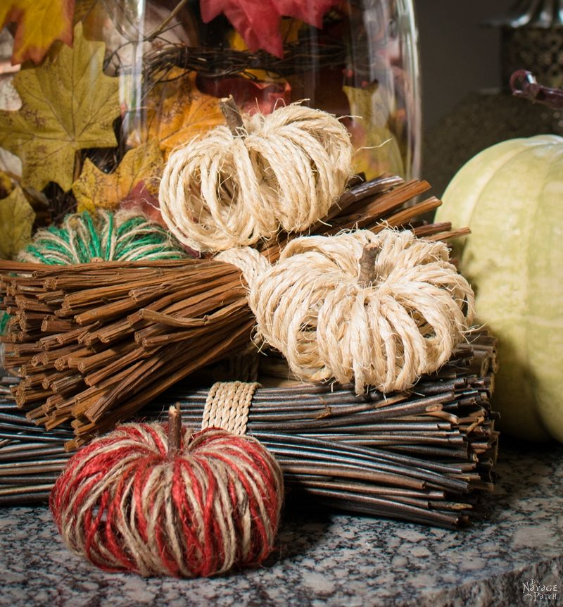sisal twine pumpkins arranged on a hearth