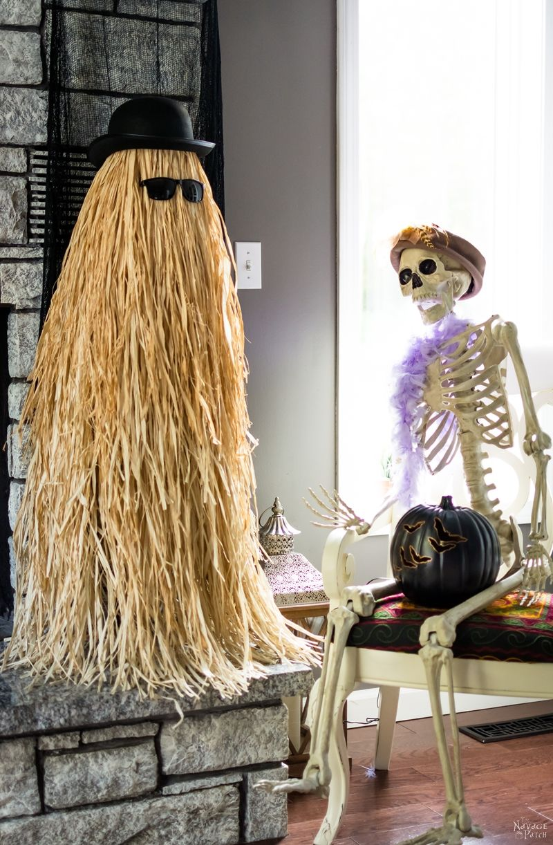 Cousin Itt Halloween prop | DIY Addams Family Cousin It | Step-by-step tutorial for how to make a Cousin It | DIY Halloween decor with Dollar store supplies | Upcycled and Repurposed Halloween decor | Upcycled tomato cage to Halloween decoration | #TheNavagePatch #Upcycle #Repurposed #halloweendecorations #halloween #DollarStore #DollarTree #easydiy #DIY #halloweenparty #Cousinit | TheNavagePatch.com
