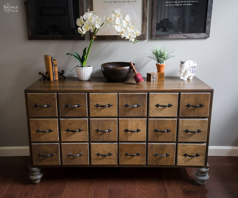 DIY Faux Card Catalog Cabinet | DIY Faux Apothecary Cabinet | Upcycled mid-century cabinet to a faux apothecary cabinet | DIY mid century cabinet makeover | How to DIY bun feet | How to mix stains to get a rustic look | #TheNavagePatch #DIY #Upcycled #Repurposed #furnituremakeover #diyfurniture #industrial #furniture #bunfeet #apothecary | TheNavagePatch.com