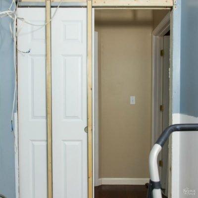 Guest Bathroom Renovation | DIY pocket door installation | How to install a pocket door | How to cut a door opening in a wall | How to make a door opening |How to paint a door | Before and After | TheNavagePatch.com