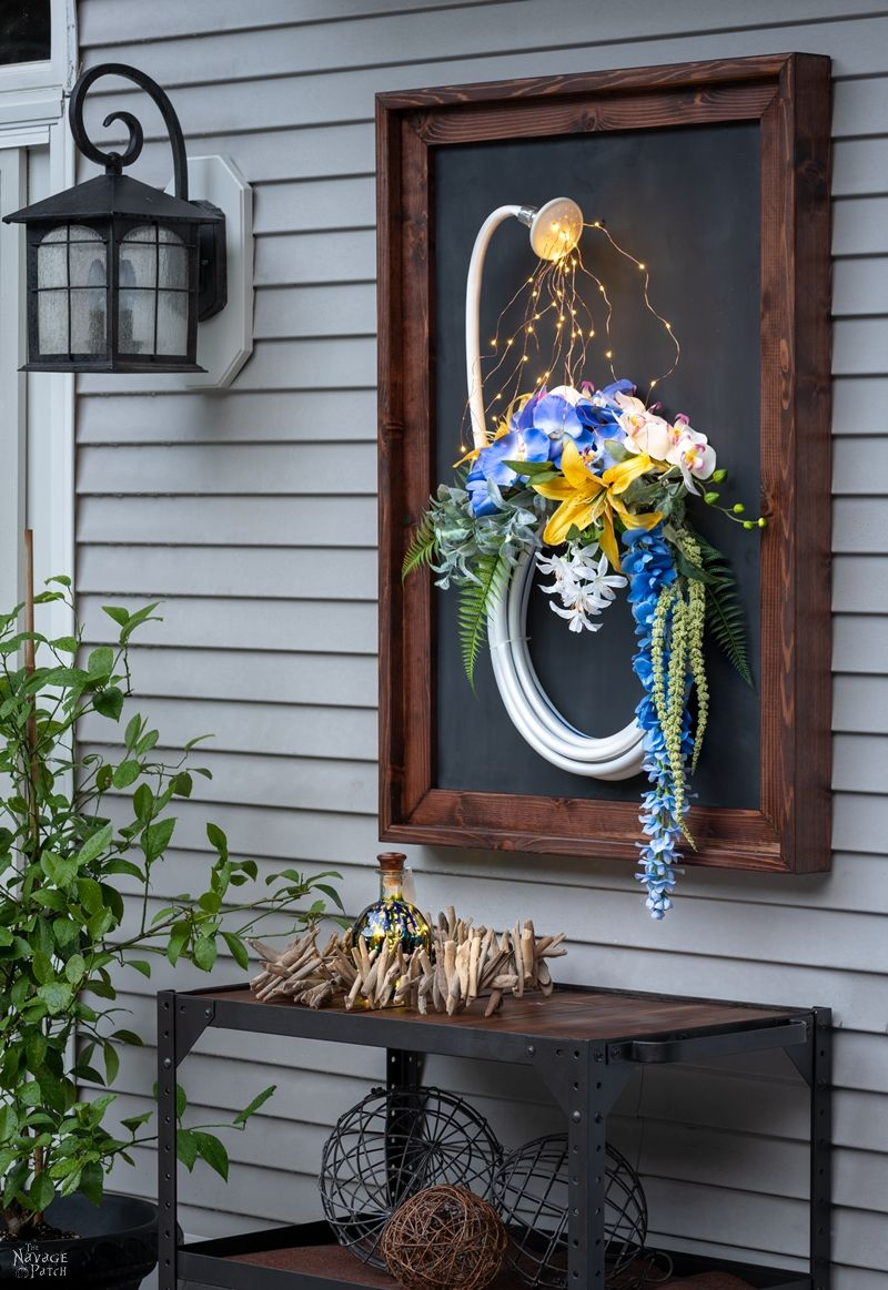 Lighted Garden Hose Wreath | DIY lighted summer wreath | Garden hose watering lights | Repurposed garden shed decor | Upcycled backyard decor | Summer wreath with fairy lights | #TheNavagePatch #GardenShed #garden #DIY #gardendecor #Upcycled #Repurposed #summerwreath #gardenart #diycrafts #Porchdecor #backyard #easydiy #outdoors #summerlife | TheNavagePatch.com