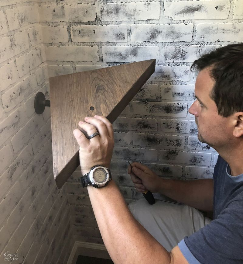 DIY Pipe Shelves   DIY industrial pipe shelves   How to get the weathered wood look   How to build pipe shelves   DIY pipe corner shelves   DIY industrial shelves   How to faux age wood using stain   #TheNavagePatch #DIY #Upcycled #diyfurniture #industrial #shelves #organization #easydiy #Laundry   TheNavagePatch.com