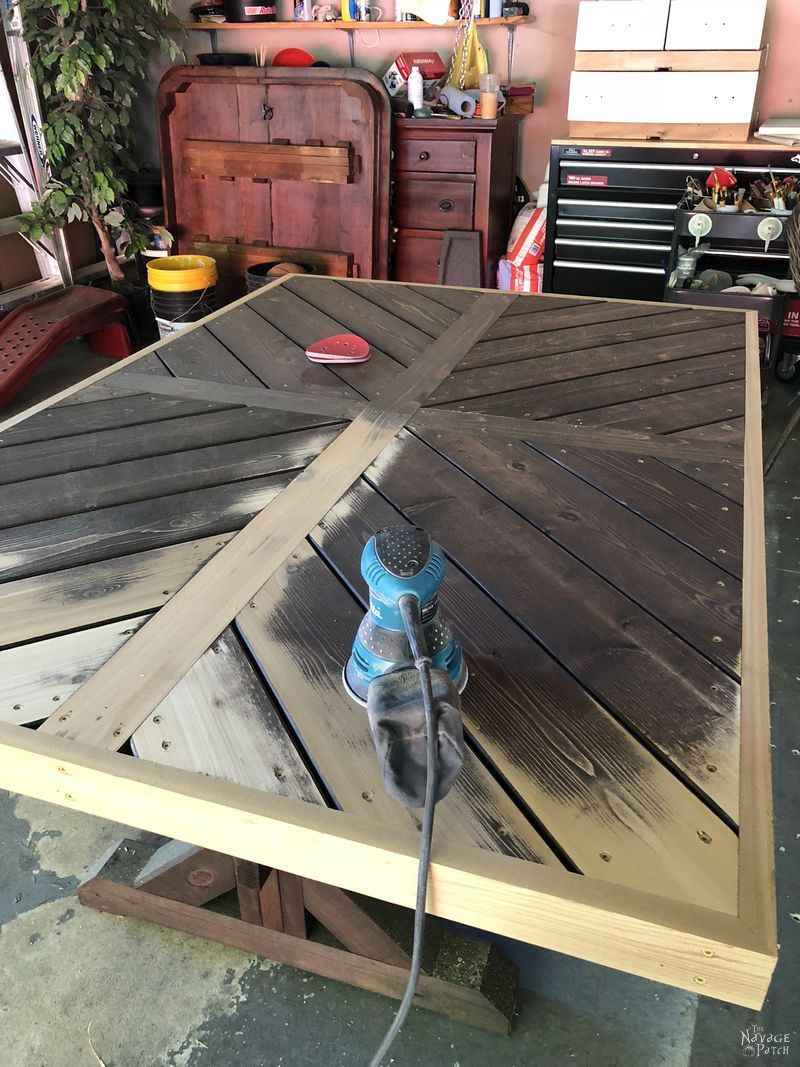 DIY farmhouse table with herringbone table top | DIY trestle table with free plans| How to make a herringbone table top | How to get the weathered wood look with stain | How to build an outdoor dining table | DIY dining table with free plans | How to get the aged wood look with stain | #TheNavagePatch #diy #farmhouse #HowTo #diyfurniture #freeplans #myrustoleum | TheNavagePatch.com