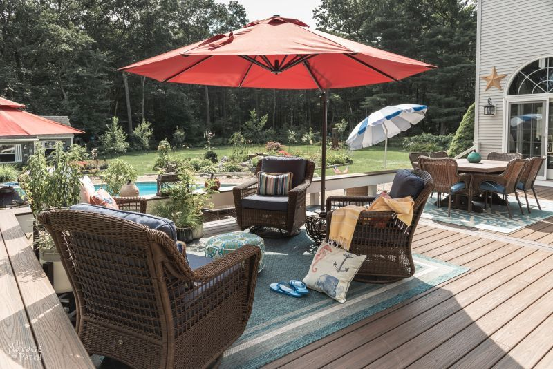 Deck Reveal | Deck decor ideas with source list | Trex Deck design ideas | How to choose a decking material | Composite deck vs pressure treated wooden decks | Trex Deck Vintage Lantern and Spiced Rum | #thenavagepatch #deck #outdoors #homedecor #diy #trex #trexdeck #deckdesign | TheNavagePatch.com