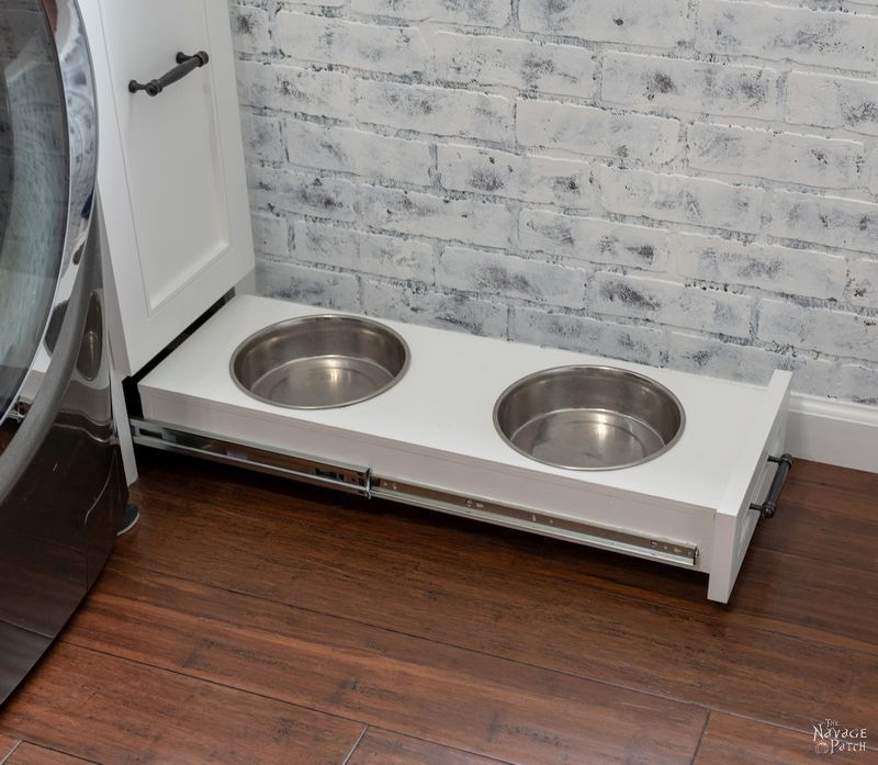 Laundry Room Cabinet with Pull-Out Shelves | DIY pull-out shelf | How to make sliding shelves for laundry room cabinet | DIY slide-out shelf and cabinet tutorial | DIY Laundry Room cabinet with Dog Feeding Station | How to install CabinetNow doors | Best paint for cabinets | #TheNavagePatch #diy #Laundry #organization #Cabinet #Tutorial #HowTo #Paintedfurniture #diyfurniture #dogfeedingstation | TheNavagePatch.com