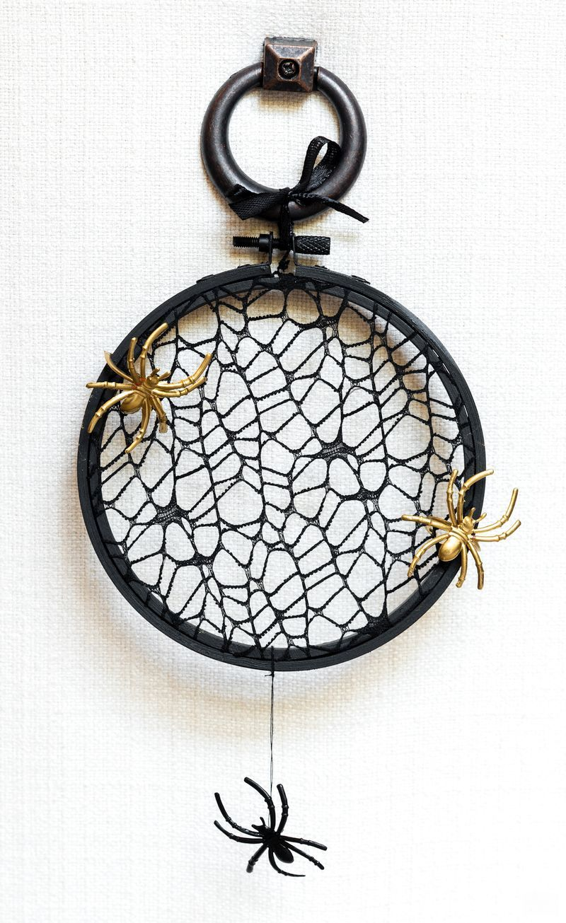 DIY Halloween Wreath (an Easy 10-Minute Craft) | Quick and easy DIY spider wreath with Dollar Store supplies | Upcycled embroidery hoop wreath | Upcycled and Repurposed Halloween decor | #TheNavagePatch #Upcycled #halloweendecorations #halloween #easydiy #DIY #DollarTree #DollarStore #halloweencrafts #spiders #halloweenparty | TheNavagePatch.com