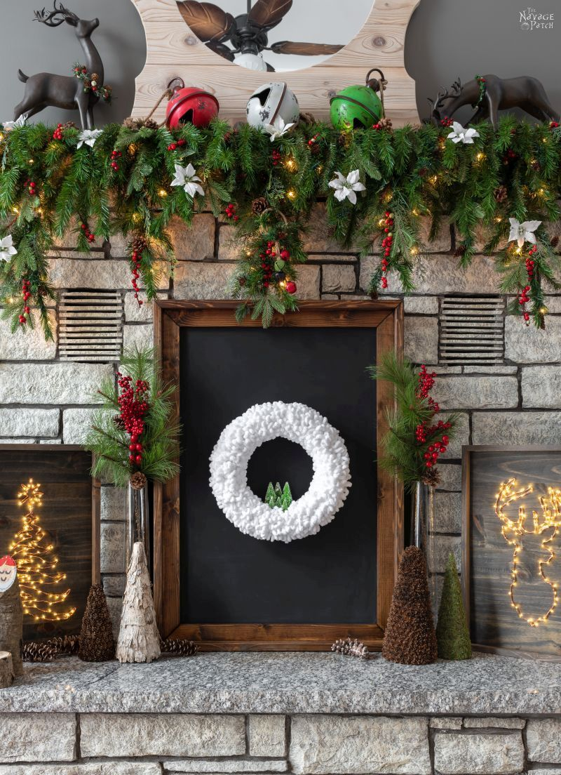 diy winter wreath set upon a fireplace hearth