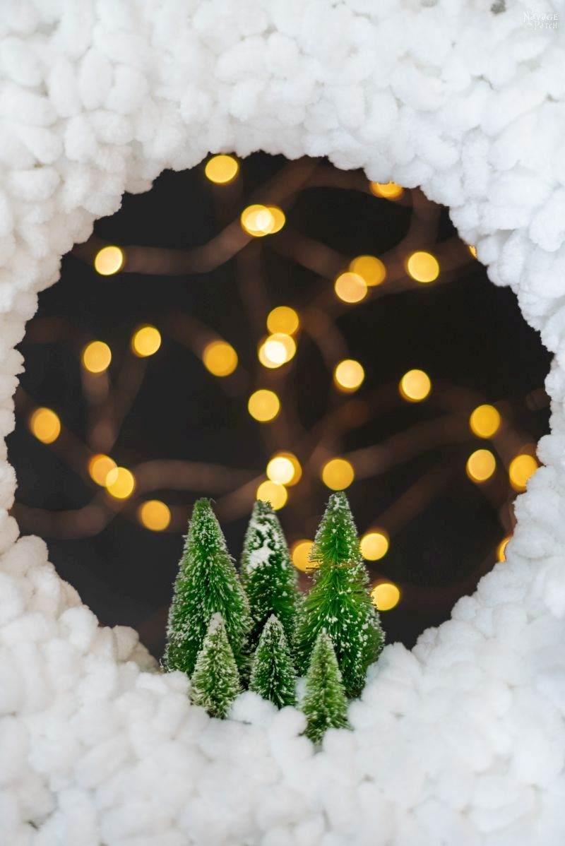 cropped photo of wreath with fairy lights in the background