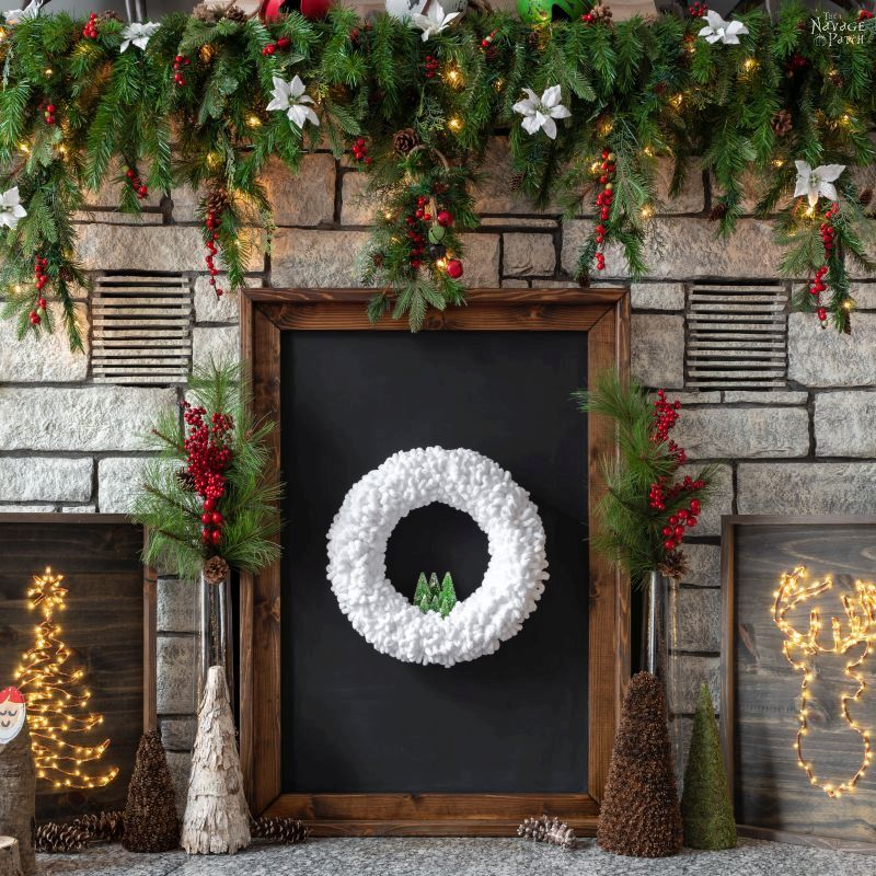 loop yarn wreath on a blackboard sitting on a hearth