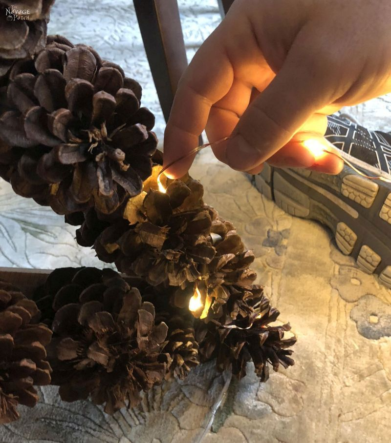DIY Lighted Pine Cone Star   How to make a pine cone star   Easy pine cone Christmas decorations   Upcycled pine cone crafts   How to make a yardstick star in less than 5 minutes   #TheNavagePatch #DIY #easydiy #pinecone #Upcycled #Repurposed #Christmas # starpattern #Holidaydecor #DIYChristmas #yardstick #Holidays #star   TheNavagePatch.com