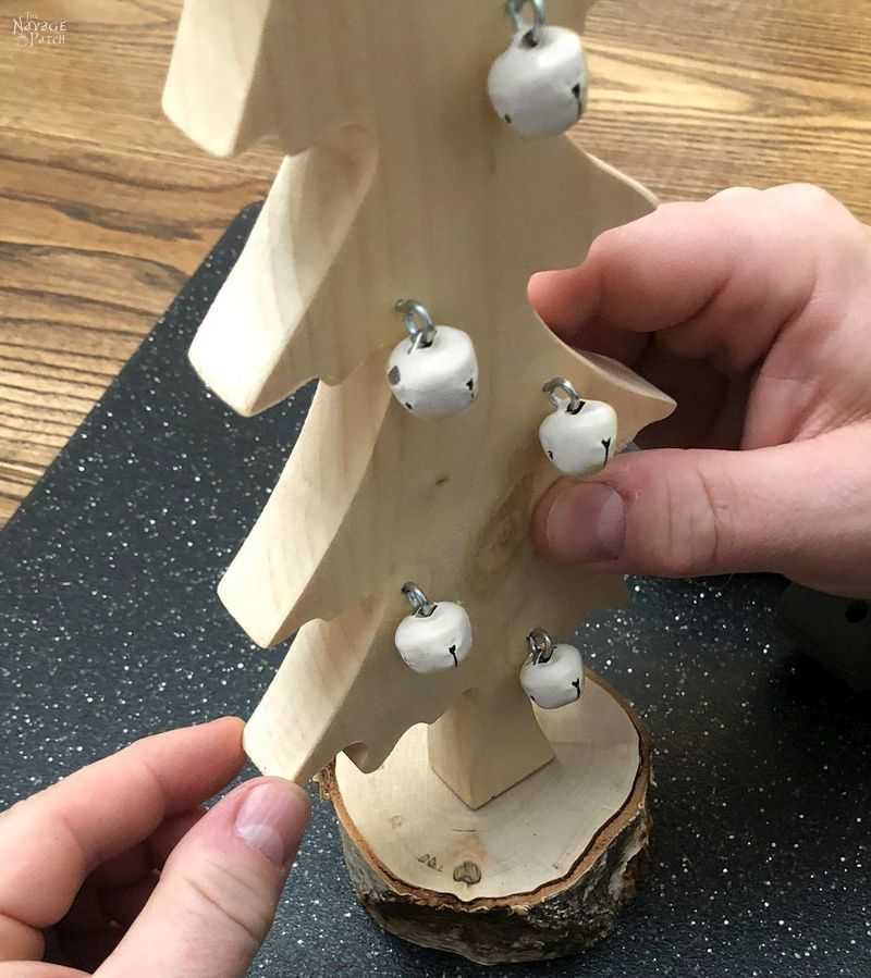 DIY Wood Alpine Tree with Jingle Bells | DIY Wooden Jingle Bell Trees with free tree pattern | How to make a wooden tree | DIY rustic wooden Christmas tree | #TheNavagePatch #easydiy #Christmas #Upcycled #DIY #freeprintable #treetemplate #treepattern #Holidaydecor #DIYChristmas #Christmascrafts #DIYHomedecor #Holidays #Alpinetree #Christmastree | TheNavagePatch.com