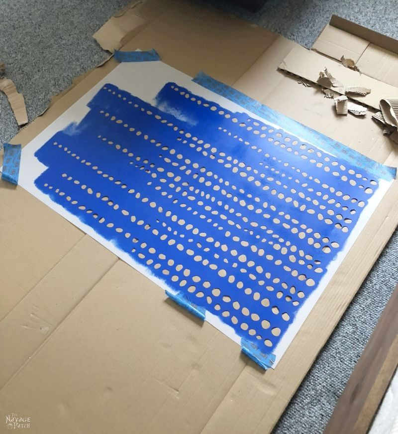 stencil laying on a cardboard