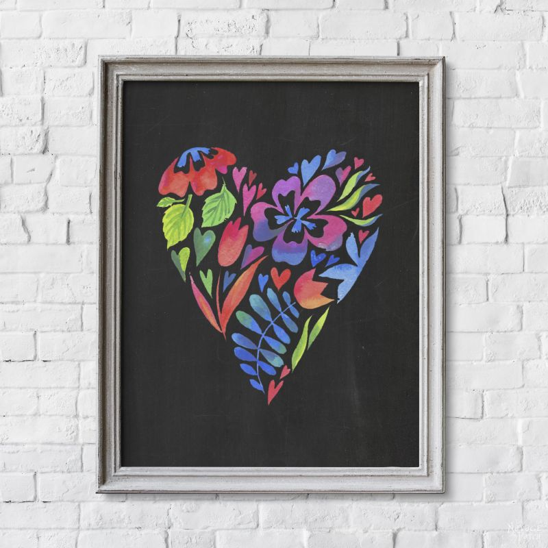 One photo frame with colorful heart isolated on white brick wall