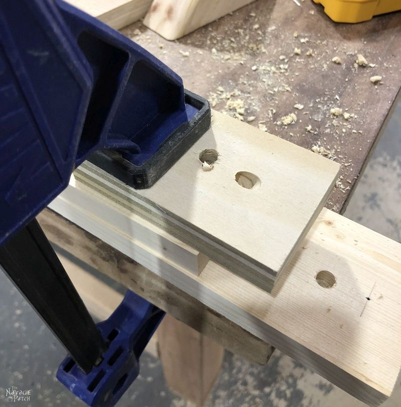 three pine boards held together with clamps