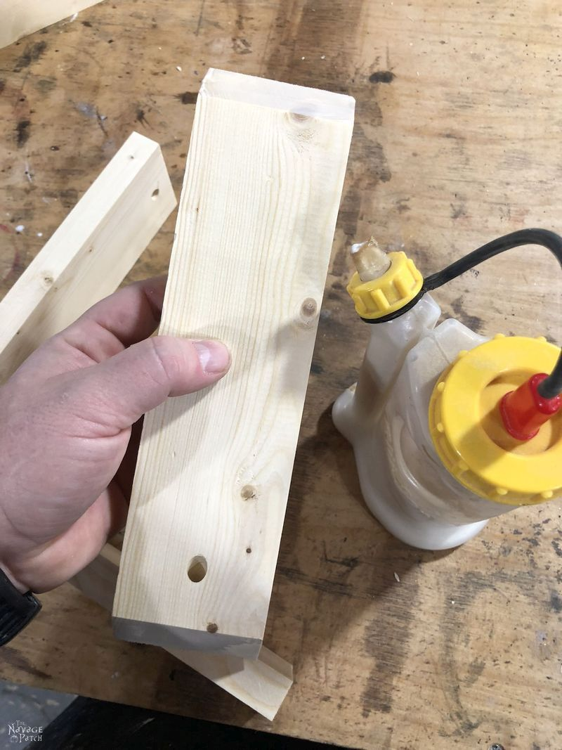 piece of pine with glue on the ends