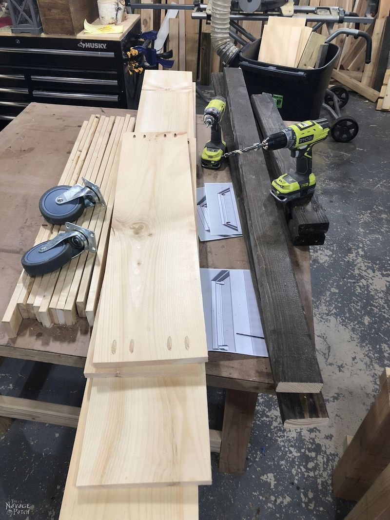 cut lumber and casters on a work table