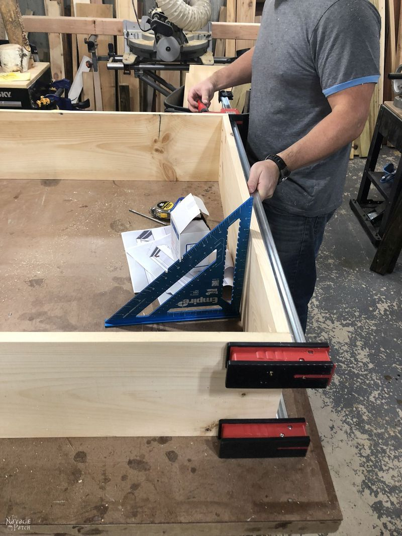 man building a daybed frame