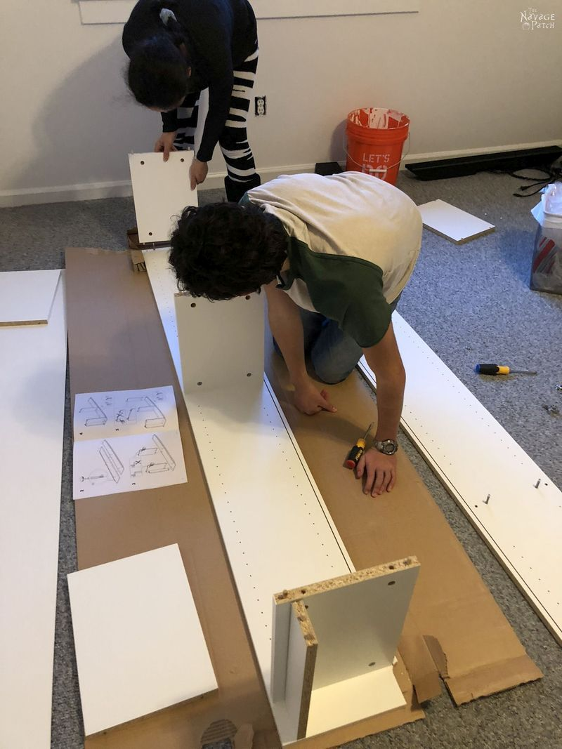mother and son assembling furniture
