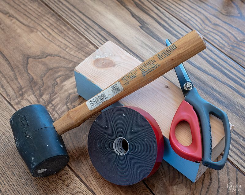 4x4, rubber mallet, double-sided tape and scissors on a table