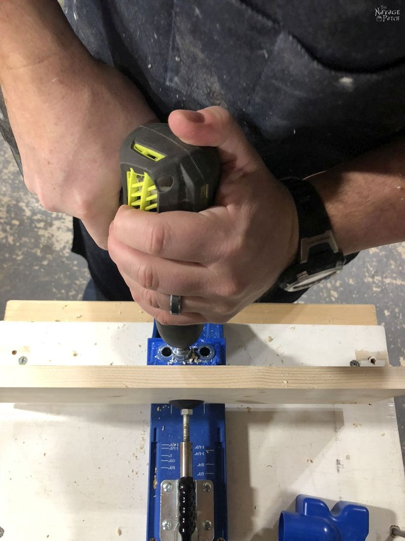 drilling picket screws into a pine board