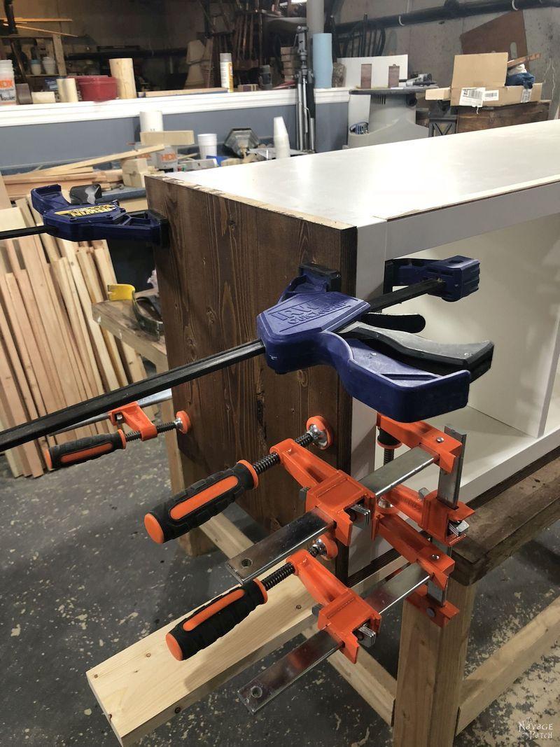 pine clamped to an ikea kallax hack