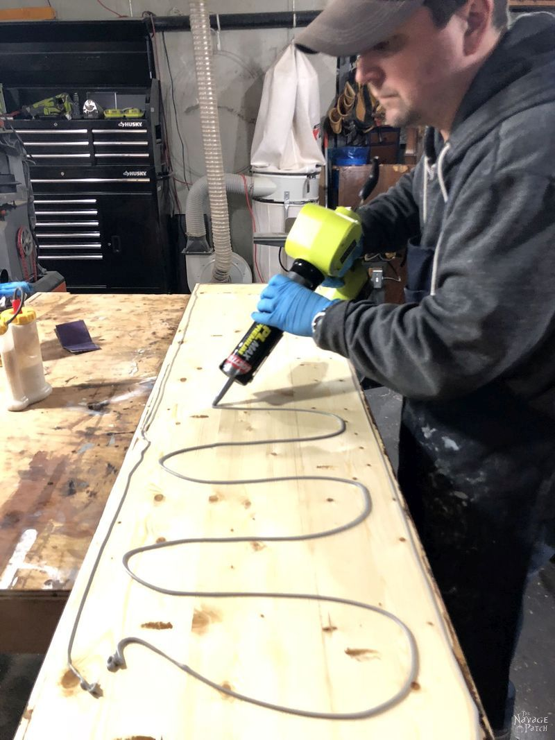applying adhesive to pine boards