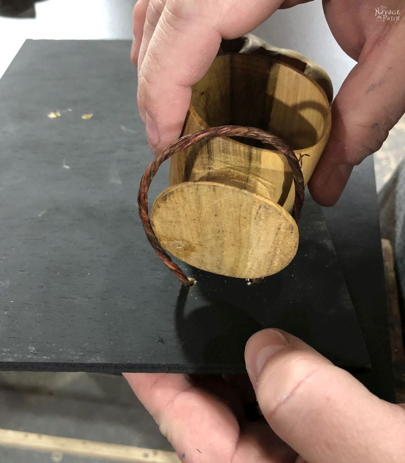 craft wire around the base of a wooden napkin ring
