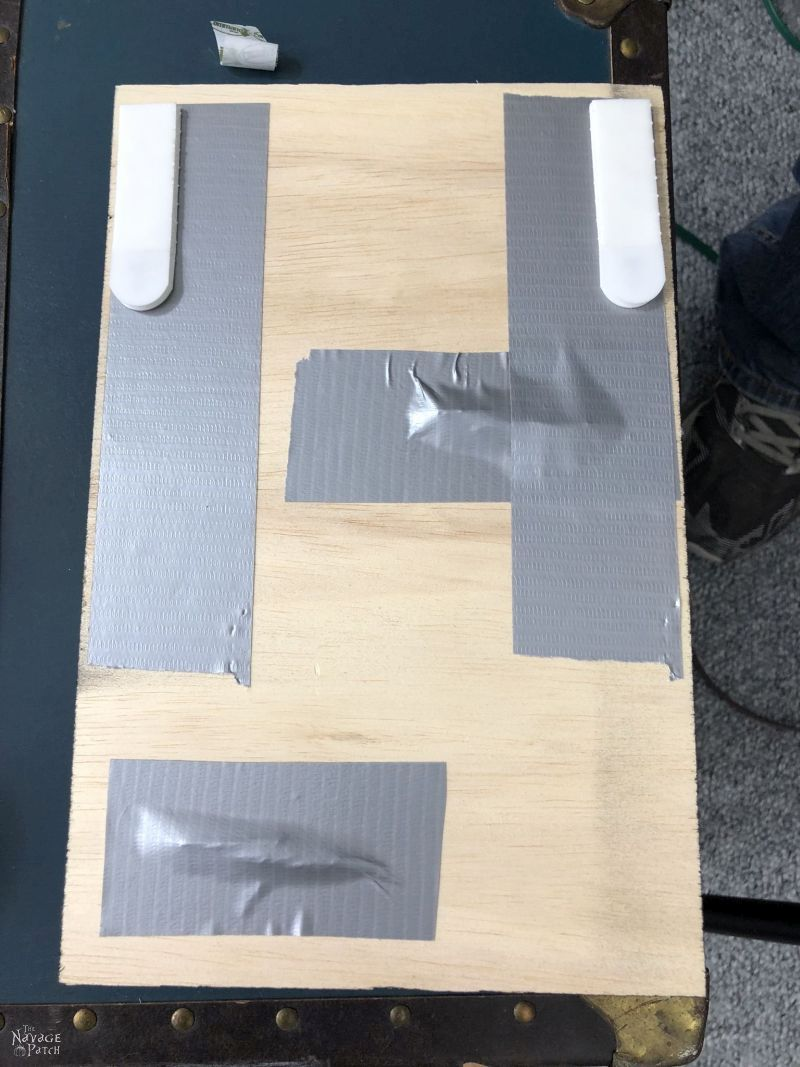plywood with duct tape on it