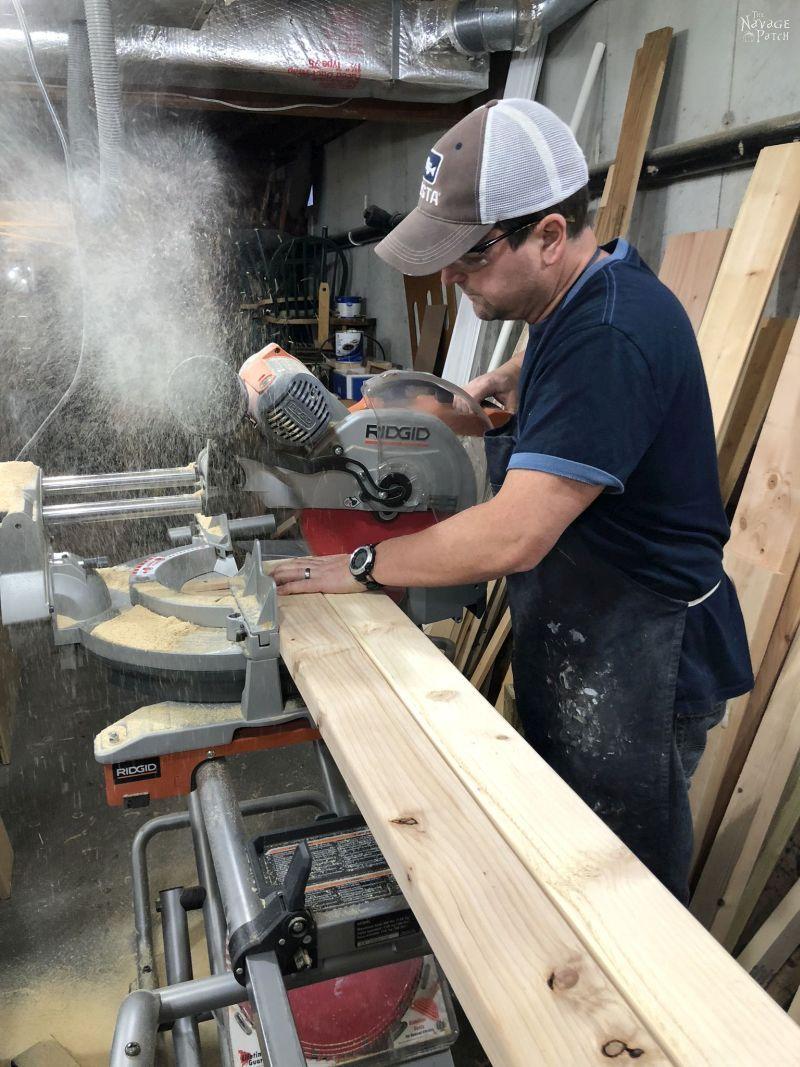 man cutting wood on a miter saw