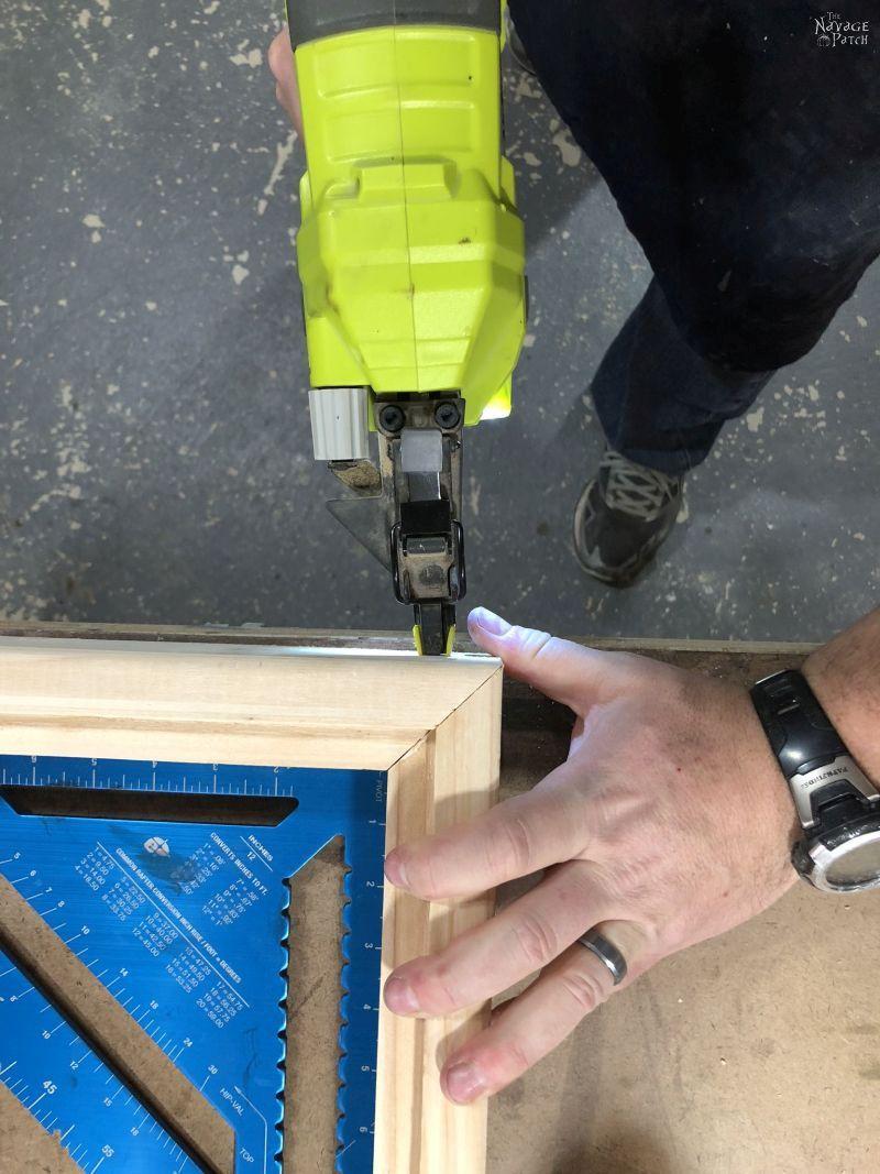 man braid nailing a frame