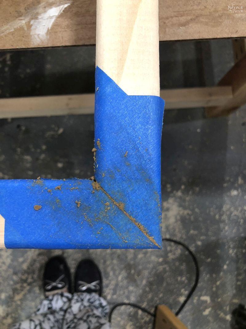 wood filler in a gap in a wooden frame