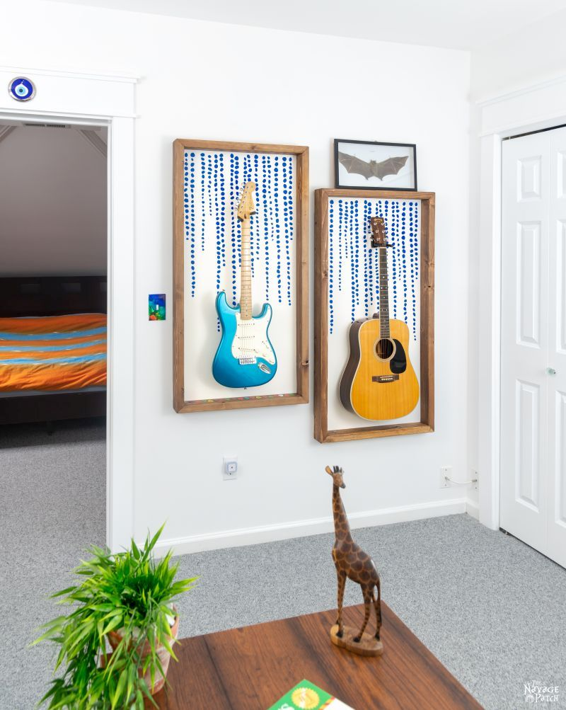 two diy guitar display frames hanging on a wall